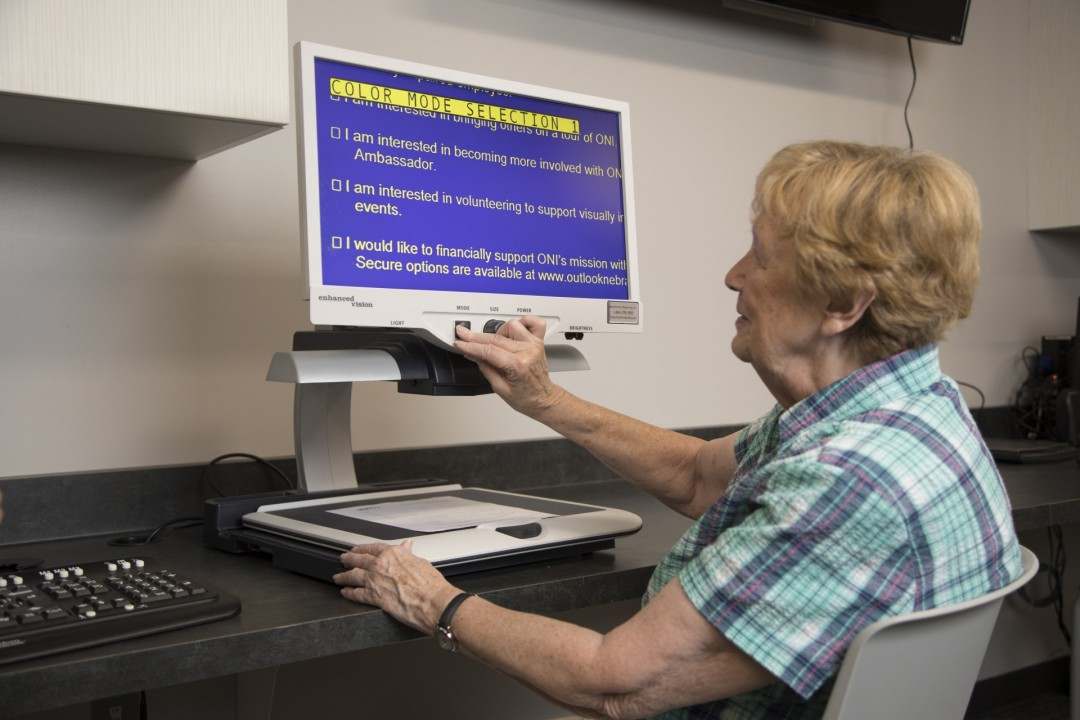 Image of woman using the CCTV in adaptive tech lab at Outlook.jpg