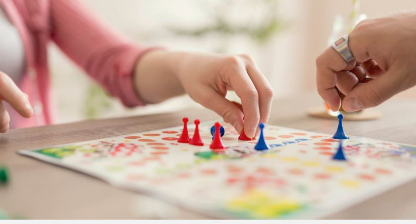 Image of two people playing a board game.