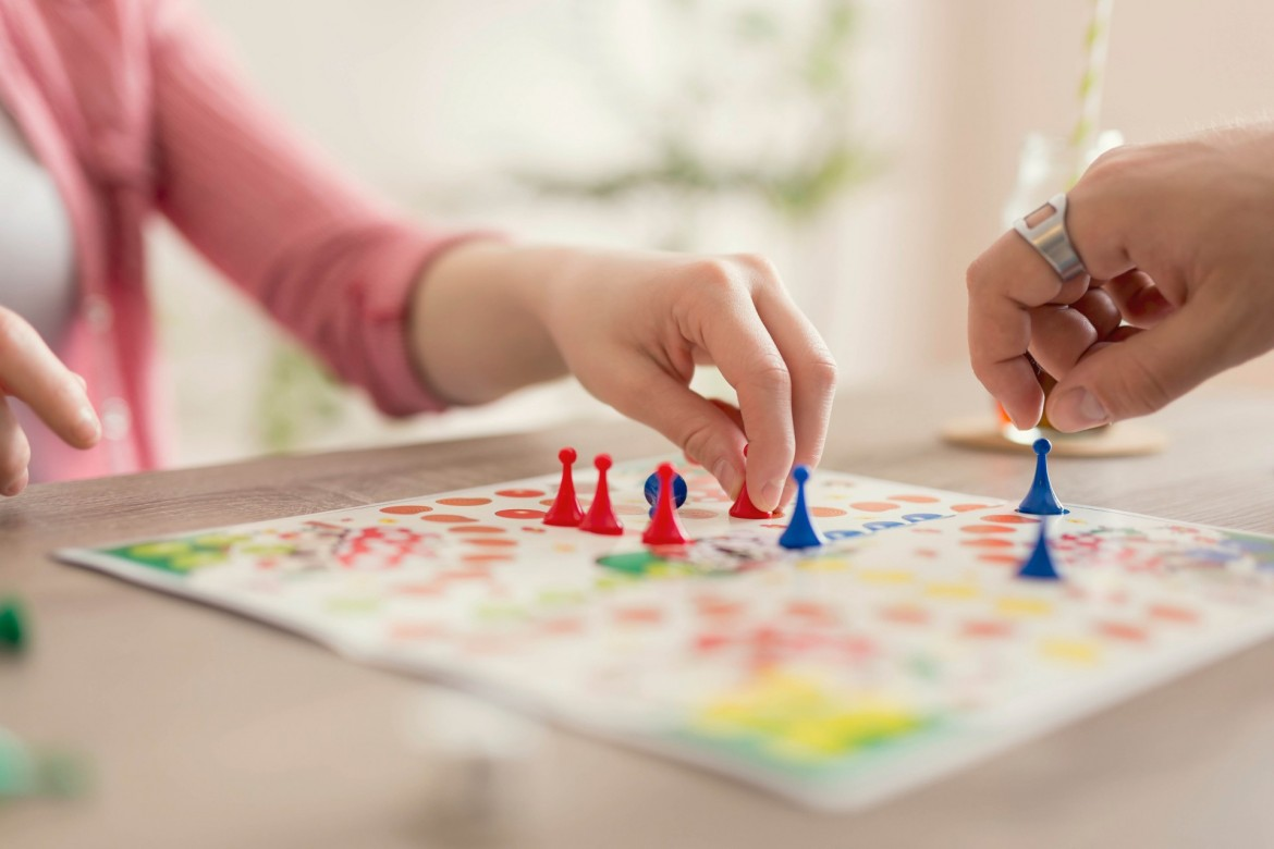 Image of people playing a board game